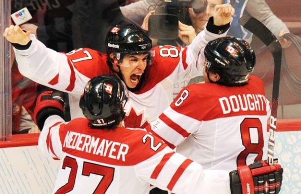 Yuri Kadobnov /Getty Images Canadian forward Sidney Crosby, centre, celebrates with teammates Scott Niedermayer and Drew Doughty after Crosby scored in overtime against the United States to help Canada win gold in the men's hockey final on Feb. 28, 2010, in Vancouver. The 3-2 victory gave Canada its record 14th Olympic gold, with No. 15 on the horizon at this month's Winter Games in Sochi, Russia.