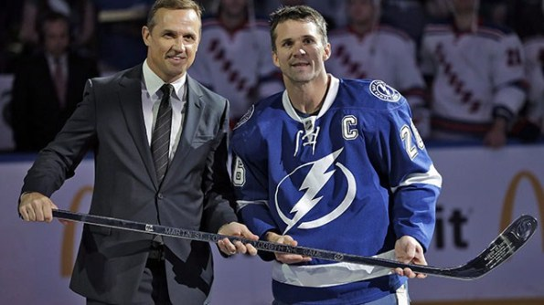 Chris O'Meara/Associated Press Tampa Bay Lightning captain Martin St. Louis and his boss, general manager Steve Yzerman, were all smiles during this pre-game ceremony. However, reports indicate their relationship soured when St. Louis was initially left off Team Canada's roster for the Sochi Olympics, for which Yzerman was also the architect. When Tampa teammate Steven Stamkos was ruled out (broken leg), St. Louis was tabbed to take his place and Canada went on to win gold, but reports persist that St. Louis wants to be traded — preferably to the New York Rangers — and he hasn't exactly denied those claims in declining to elaborate on his conversations with Yzerman regarding his future.