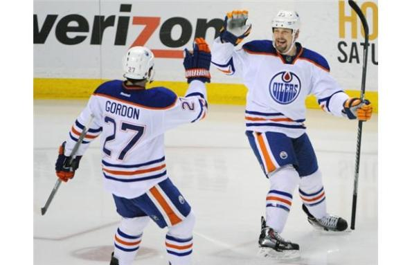 The Associated PressEdmonton Oilers forward Matt Hendricks, right, celebrates his go-ahead goal with linemate Boyd Gordon during third-period NHL action against the Buffalo Sabres on Monday in Buffalo. Hendricks' goal, on a shorthanded breakaway, stood up as the winner in Edmonton's 3-2 victory. The Oilers seem to be making strides, winning four of their last five games.