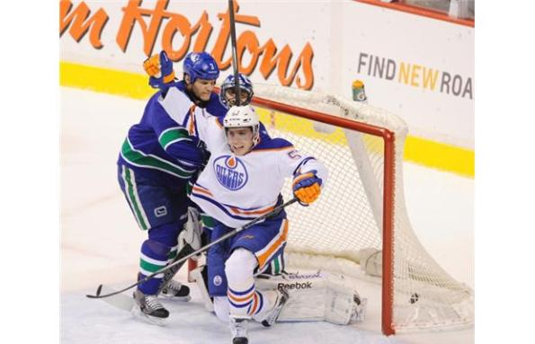The Canadian PressEdmonton Oilers forward David Perron celebrates his goal much to the chagrin of Vancouver Canucks defenceman Kevin Bieksa and goaltender Roberto Luongo during NHL action in Vancouver last Monday. Perron scored a hat trick and Edmonton prevailed 4-2.