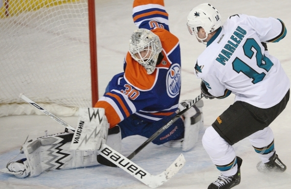 Ed Kaiser/Edmonton Journal Edmonton Oilers goaltender Ben Scrivens makes a breakaway save on San Jose Sharks forward Patrick Marleau during NHL action at Rexall Place in Edmonton last Wednesday. Scrivens set a new NHL-record with a 59-save shutout in Edmonton's 3-0 win.