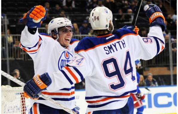 Maddie Meyer/Getty Images Edmonton Oilers forward David Perron, left, congratulates Ryan Smyth on opening the scoring against the New York Rangers during first-period NHL action in New York on Thursday. It was a vintage Smyth goal as the ageless wonder (who is actually turning 38 this month) went to the net and shovelled in a gift-wrapped rebound of Perron's shot. The Oilers went on to win 2-1.