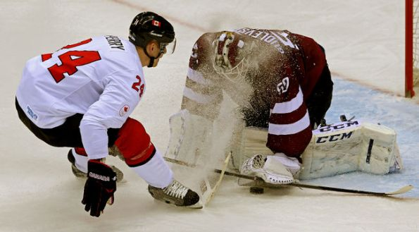 Al Charest/Calgary Sun Not even this snow shower by Team Canada forward Corey Perry could rattle Latvia goaltender Kristers Gudlevskis during their quarter-final game at the 2014 Winter Olympics in Sochi, Russia, on Wednesday. Gudlevskis smothered this scoring chance before Perry could poke the puck past him and stopped 55 shots in total, but it wasn't enough for Latvia as Canada prevailed 2-1 on Shea Weber's go-ahead goal in the third period. With the win, defending Olympic champion Canada advanced to the semifinals — as expected — and will next face the archival United States on Friday in a rematch of the 2010 gold-medal game in Vancouver, which Canada won 3-2 in overtime.