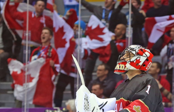 Jean Levac/Postmedia Olympic Team Fans celebrate Canada's fourth goal against Austria as Roberto Luongo looks up at the video replay during second-period action of the men's hockey preliminary round held at the Bolshoy Ice Dome during the 2014 Olympics in Sochi, Russia, on Friday. Luongo made 20 saves, including a handful of quality ones, in Canada's 6-0 shutout win that also featured a natural hat trick by Jeff Carter. Canada next faces Finland on Sunday in another 9 a.m. PT puck-drop.