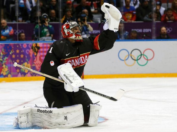 PHIL NOBLE/Reuters Team Canada goaltender Roberto Luongo gloves down a shot in making one of his 23 saves against Austria during Friday's 6-0 shutout win in preliminary-round action at the 2014 Olympics in Sochi, Russia. Luongo's flawless showing might have been enough to cement him as Canada's starter against Finland on Sunday.