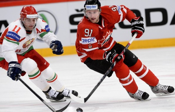 Jonathan Nackstrand/Getty Images Steven Stamkos, right, seen here representing Canada against Belarus in international competition, won't be making the trip to Sochi. The Tampa Bay Lightning sniper was not cleared by doctors as his attempted recovery from a broken leg fell just short and his spot on Canada's roster was awarded to Tampa Bay teammates Martin St. Louis. Stamkos will certainly be missed as he was expected to complement Sidney Crosby on the team's top scoring line.
