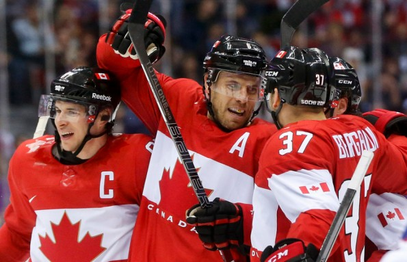 Julio Cortez/The Associated Press Team Canada defenceman Shea Weber, centre, celebrates with forwards Sidney Crosby, left, and Patrice Bergeron after scoring a goal against Norway during their round-robin game at the 2014 Olympics in Sochi, Russia, on Thursday. Weber opened the scoring in the second period and Canada went on to win 3-1.