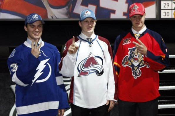 Dave Sandford/Getty Images The top three picks from the 2013 NHL Entry Draft, from left, Jonathan Drouin of the Tampa Bay Lightning, Nathan MacKinnon of the Colorado Avalanche and Aleksander Barkov of the Florida Panthers, pose together shortly after being selected at the Prudential Center in Newark, New Jersey, last June. MacKinnon has since enjoyed a stellar debut season and is the favourite to win the Calder Trophy at this month's awards banquet after setting several rookie records. Barkov also made the immediate jump to the NHL and was turning heads before getting hurt, while Drouin dominated the junior ranks again and is expected to challenge for the Calder in 2014-15. Notably absent from this photo is Seth Jones, who was taken fourth overall by the Nashville Predators and also played in the NHL this season, logging significant minutes and even partnering with Shea Weber towards the end of the campaign. Prior to the 2013 draft, most pundits were predicting Jones and MacKinnon to go 1st and 2nd overall with the order a topic of debate until the Avs announced ahead of time that they would be taking MacKinnon, but Jones surprisingly slipped to No. 4. There's even more uncertainty surrounding the 2014 edition of the NHL draft on June 27 in Philadelphia.
